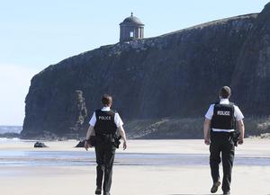 PSNI officers patrol a deserted Downhill Beach underneath Mussenden Temple in County Londonderry to deter visitors during the COVID-19 crisis. Picture: Michael Cooper