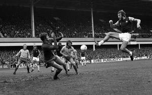 Dai Davies, playing for Everton, saves from West Ham captain Billy Bonds (PA).