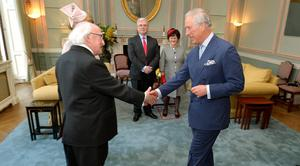The President of Ireland Michael D Higgins shakes hands with the Prince of Wales, as the Prince welcomed him to the UK for a five day state visit, at the Irish Embassy in central London