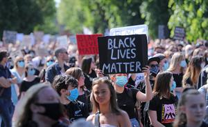 People at a Black Lives Matter protest rally outside the US Embassy in Dublin (Niall Carson/PA)