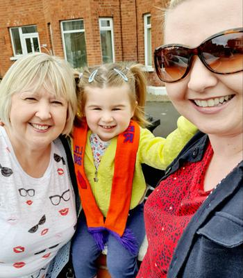 Abigail Flack enjoying the 12th in east Belfast. With her mum Lisa Flack and nana Sharon Wylie.