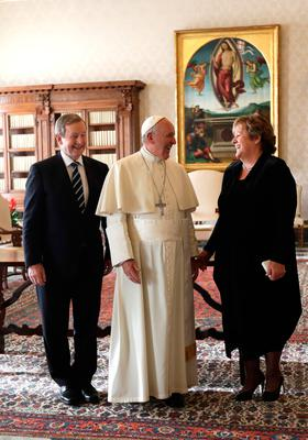 Pope Francis laughs with Taoiseach Enda Kenny and his wife Fionnuala, during a private audience on November 28, 2016 at the Vatican.  / AFP PHOTO / POOL / Alessandra TarantinoALESSANDRA TARANTINO/AFP/Getty Images