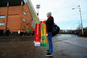 NORWICH, ENGLAND - JANUARY 23:  Matchday scarves are on sale prior to the Barclays Premier League match between Norwich City and Liverpool at Carrow Road on January 23, 2016 in Norwich, England.  (Photo by Stephen Pond/Getty Images)