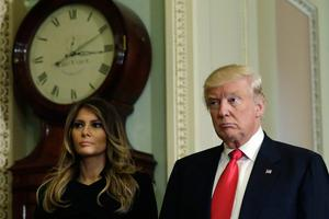 US President-elect Donald Trump talks to the media with his wife Melania Trump on Capitol Hill in Washington, DC on November 10, 2016.  / AFP PHOTO / YURI GRIPASYURI GRIPAS/AFP/Getty Images