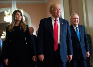 US President-elect Donald Trump and his wife Melania walk with Senate Majority Leader Mitch McConnell (R) following a meeting at the Capitol in Washington, DC, on November 10, 2016. / AFP PHOTO / NICHOLAS KAMMNICHOLAS KAMM/AFP/Getty Images