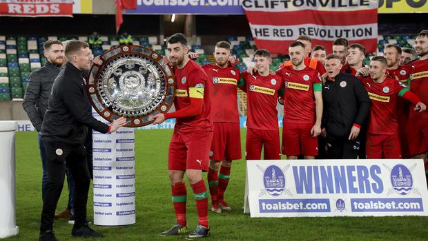 PACEMAKER PRESS BELFAST  21/1/2020  Toals Co. Antrim Shield 2019/20  Cliftonville celebrations after tonight's win over Ballymena United at Windsor Park. Captain Joseph Gormley lifts the trophy. Photo Laura Davison/Pacemaker Press