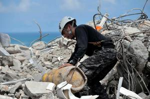 A member of Ecuador's Special Operations Group searches for survivors in one of Ecuador's worst-hit towns, Pedernales, two day after a 7.8-magnitude quake hit the country, on April 19, 2016. Rescuers and desperate families clawed through the rubble Monday to pull out survivors of an earthquake that killed 350 people and destroyed towns in a tourist area of Ecuador. / AFP PHOTO / RODRIGO BUENDIARODRIGO BUENDIA/AFP/Getty Images