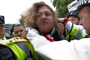 A pro-Palestinian demonstrator is restrained by police during a protest outside the gates of Downing Street in London on September 9, 2015. Over 100 pro-Israeli demonstrators and hundreds of pro-Palestinian activists rallied in front of Downing Street in London ahead of a planned visit of Israeli Prime Minister Benjamin Netanyahu. Netanyahu visits Britain this week for talks with his counterpart David Cameron as the right-wing Israeli leader faces diplomatic pressure over West Bank settlements and stalled peace efforts. AFP PHOTO / JUSTIN TALLISJUSTIN TALLIS/AFP/Getty Images