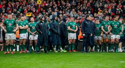 Hard to watch: Ireland's players look on at Welsh celebrations last weekend