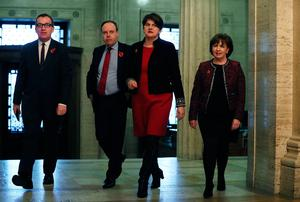 DUP leader Arlene Foster (second right) and deputy leader Nigel Dodds (second left) arrive to speak to the media in the Great Hall at Stormont. Brian Lawless/PA Wire