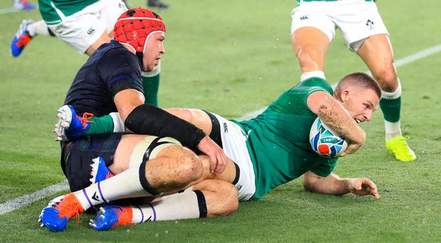 Andrew Conway, right, scores Ireland's bonus-point try against Scotland at the World Cup (Adam Davy/PA)