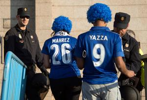 Police officers check Leicester City supporters before the UEFA Champions League quarter final first leg football match Club Atletico de Madrid vs Leicester City at the Vicente Calderon stadium in Madrid on April 12, 2017. / AFP PHOTO / CURTO DE LA TORRECURTO DE LA TORRE/AFP/Getty Images