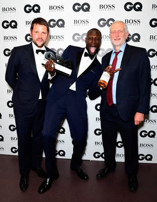 Stormzy with his Copper Dog Whiskey Solo Artist award with Gordon Smart (left) and Jeremy Corbyn during the GQ Men of the Year Awards 2017 held at the Tate Modern, London. PRESS ASSOCIATION Photo. Picture date: Tueday September 5th, 2017. Photo credit should read: Ian West/PA Wire