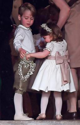 Prince George and Princess Charlotte at the wedding of the Duchess of Cambridge's sister Pippa Middleton to her millionaire groom James Matthews, dubbed the society wedding of the year at, St Mark's church in Englefield, Berkshire. PRESS ASSOCIATION Photo. Picture date: Saturday May 20, 2017. See PA story ROYAL Pippa. Photo credit should read: Andrew Matthews/PA Wire