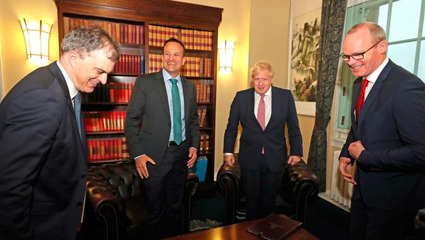 Secretary of State for Northern Ireland, Julian Smith (left), Taoiseach, Leo Varadkar (centre left), Prime Minister, Boris Johnson (centre right) and Ireland's deputy premier, Tanaiste, Simon Coveney (right) in the Parliament Buildings, Stormont, Belfast. PA Photo. Picture date: Monday January 13, 2020. Pic: Liam McBurney/PA Wire