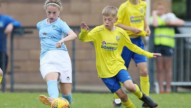PressEye-Northern Ireland- 1st August 2019-Picture by Brian Little/PressEye Dungannon United Youth  Elijah Weathered and Ballymena United  Abi Sweetlove  in  STATSports SuperCupNI  Semi Final , at Anderson Park, Coleraine . Picture by Brian Little/PressEye