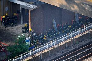 LONDON, ENGLAND - JUNE 14:  Fire fighters take a rest near the building after a huge fire engulfed the 24 story Grenfell Tower in Latimer Road, West London in the early hours of this morning on June 14, 2017 in London, England.  The Mayor of London, Sadiq Khan, has declared the fire a major incident as more than 200 firefighters are still tackling the blaze, while at least 30 people are receiving hospital treatment.  (Photo by Leon Neal/Getty Images)