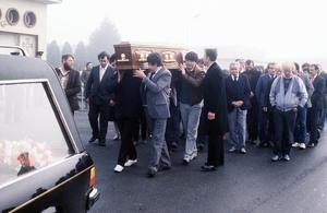 The body of Mrs Mary McGlinchey being removed from Dundalk hospital to be taken North to her fathers home near Toomebridge.   Pictures of sons Declan and Dominic who witnessed the shooting, father of Mary Mr Paddy McNeill carrying the coffin as it arrives home in Toomebridge.  Pacemaker Press Intl. 2/2/87  73/87/C