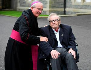 LONDONDERRY, NORTHERN IRELAND - AUGUST 11: Civil Rights activist during Bloody Sunday Ivan Cooper (R) arrives for the funeral of the late retired Bishop of Derry, Dr. Edward Daly as he lies in state at St. Eugene's Cathedral on August 11, 2016 in Londonderry, Northern Ireland. The iconic image of the then Fr Daly waving a hankerchief over one of the Bloody Sunday victims became one of the most enduring images of the Troubles in Northern Ireland. Bishop Daly who has been described as a fearless peace-builder passed away at the age of 82 following a brief illness, he will be buried this afternoon in the grounds of the cathedral following requiem mass. (Photo by Charles McQuillan/Getty Images)