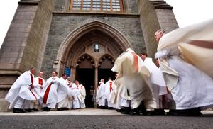 LONDONDERRY, NORTHERN IRELAND - AUGUST 11: Priests stand in procession for the funeral of the late retired Bishop of Derry, Dr. Edward Daly as he lies in state at St. Eugene's Cathedral on August 11, 2016 in Londonderry, Northern Ireland. The iconic image of the then Fr Daly waving a hankerchief over one of the Bloody Sunday victims became one of the most enduring images of the Troubles in Northern Ireland. Bishop Daly who has been described as a fearless peace-builder passed away at the age of 82 following a brief illness, he will be buried this afternoon in the grounds of the cathedral following requiem mass. (Photo by Charles McQuillan/Getty Images)