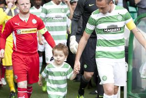 Celtic v Cliftonville, Champions League second qualifying round second leg - 23 July 2013. Oscar Knox with Celtic skipper Scott Brown ahead of the Celtic v Cliftonville match