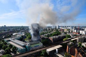 Smoke rises from the building after a huge fire engulfed the 24 story Grenfell Tower in Latimer Road (Photo by Leon Neal/Getty Images)