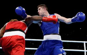 Ireland's Joseph Ward, right, fights Ecuador's Carlos Andres Mina during a men's light heavyweight 81-kg preliminary boxing match at the 2016 Summer Olympics in Rio de Janeiro, Brazil, Wednesday, Aug. 10, 2016. (AP Photo/Frank Franklin II)