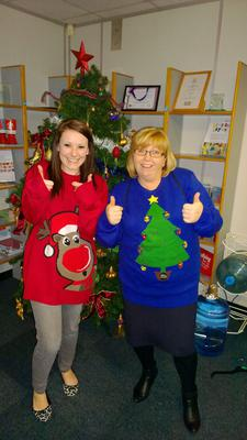 Melissa and Annette and their bright Christmas jumpers for Save the Chidren pic. Save the Children