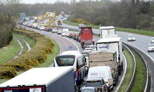 Recovery vehicles pictured at the scene on the M1 motorway into Belfast where a Heavy Goods Vehicle mounted the central reservation. Photo: Stephen Hamilton /Presseye