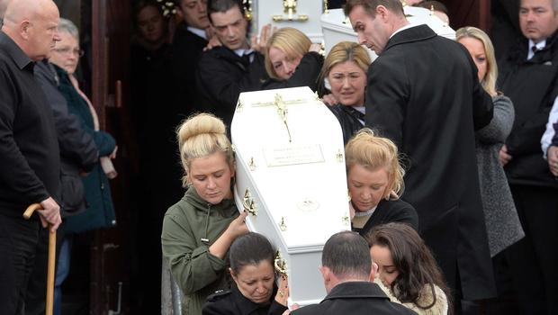 PACEMAKER BELFAST   24/03/2016 Louise James (front -left) one of five Coffins during The funeral of five pier victims takes place at Holy Family Church, Ballymagroarty on Thursday. The victims were Ruth Daniels, her 14-year-old daughter Jodie Lee Daniels, her son-in-law Sean McGrotty, and his sons Mark, 12, and Evan, eight.  The only survivor was Mr McGrotty's four-month old daughter, Rionaghac-Ann. They died after their car slid off a pier in Buncrana County Donegal. Photo Colm Lenaghan/Pacemaker Press