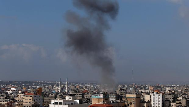 Smoke rises after an Israeli missile strike in Gaza City, Tuesday, July 15, 2014. Egypt presented a cease-fire plan Monday to end a week of heavy fighting between Israel and Hamas militants in the Gaza Strip that has left at least 185 people dead, and both sides said they were seriously considering the proposal.The late-night offer by Egypt marked the first sign of a breakthrough in international efforts to end the conflict. (AP Photo/Lefteris Pitarakis)