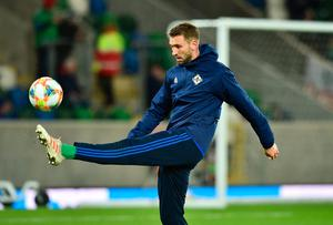 BELFAST, NORTHERN IRELAND - MARCH 24:  Gareth McAuley of Northern Ireland warms up prior to the 2020 UEFA European Championships Group C qualifying match between Northern Ireland and Belarus at Windsor Park on March 24, 2019 in Belfast, United Kingdom. (Photo by Charles McQuillan/Getty Images)