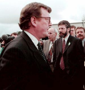 PACEMAKER BELFAST 08/04/98: Ulster Unionist Party leader, David Trimble and Sinn Fein President, Gerry Adams pass within touching distance outside Castle  Buildings, Stormont during a break in the negotiations before the signing of the Good Friday Agreement.