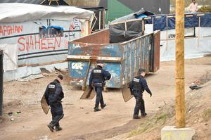 "Workers dismantle shelters in the ""jungle"" migrants and refugees camp in Calais, northern France. Pic Getty Images"