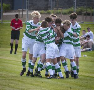 CELTIC DELIGHT!. . . .Glasgow Celtic players celebrate after their opening goal against Donegal Schoolboys in the Hughes Insurance Foyle Cup at Brooke Park, Derry on Tuesday evening. FC02-T2-08