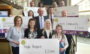 Some of last year's beneficiaries pictured with Mark Walker of Hilton NI and Sunday Life editor Martin Breen.