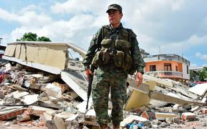 A soldier patrols the streets of Manta, in the Ecuadorean coastal province of Manabi, on April 18, 2016 two days after a 7.8-magnitude quake hit the country. Rescuers and desperate families clawed through the rubble Monday to pull out survivors of an earthquake that killed 350 people and destroyed towns in a tourist area of Ecuador. / AFP PHOTO / LUIS ACOSTALUIS ACOSTA/AFP/Getty Images
