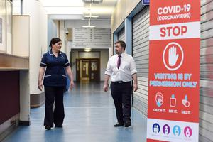 Health Minister Robin Swann and Chief Nursing Officer Charlotte McArdle visited Northern Ireland's Nightingale Hospital.  During the visit they met with front line staff and saw the new intensive care facilities. Picture: Michael Cooper