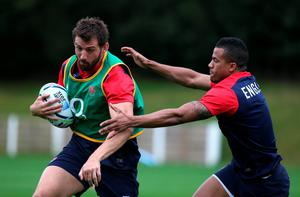 Tom Wood is held by Anthony Watson during an England training session