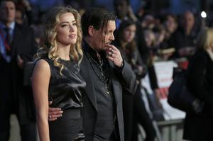 Amber Heard and Johnny Depp married in Los Angeles in February 2015 (Jonathan Brady/PA)