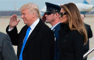 US President-elect Donald Trump and wife Melania Trump step off a plane upon arrival at Andrews Air Force Base in Maryland on January 19, 2017. / AFP PHOTO / MANDEL NGANMANDEL NGAN/AFP/Getty Images