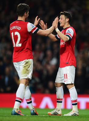 LONDON, ENGLAND - APRIL 28:  Mesut Oezil of Arsenal (11) celebrates with Olivier Giroud as he scores their second goal during the Barclays Premier League match between Arsenal and Newcastle United at Emirates Stadium on April 28, 2014 in London, England.  (Photo by Jamie McDonald/Getty Images)