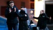Agony and ecstasy: Rangers boss Steven Gerrard (left) savours Old Firm delight while Celtic's Neil Lennon (right) deals with the pain of defeat.