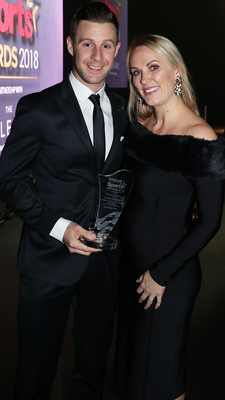 At the double: Jonathan Rea, along with wife Tatia, with the Sports Star of the Year Award last night