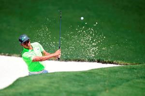 US golfer Rickie Fowler hits out of a bunker during Round 1 of the 80th Masters Golf Tournament at the Augusta National Golf Club on April 7, 2016, in Augusta, Georgia.   / AFP PHOTO / Jim WatsonJIM WATSON/AFP/Getty Images