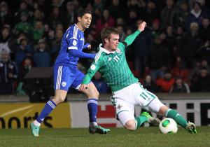 Northern Ireland's Chris Brunt with Israel's Maor Melikson during Tuesday night's World Cup Qualifier at Windsor Park, Belfast