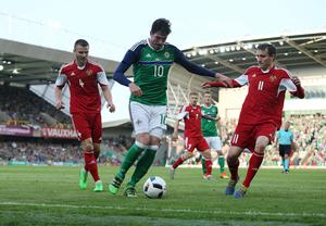 @Press Eye Ltd Northern Ireland- 27th May 2016 Mandatory Credit -Brian Little/Presseye  Northern Ireland  Kyle Lafferty challenged by  Belarus  Ihar Shitau and  Mikhail Hardzeichuk    during Friday night's Vauxhall Friendly International match  at the National Football Stadium at Windsor Park. Picture by Brian Little/Presseye