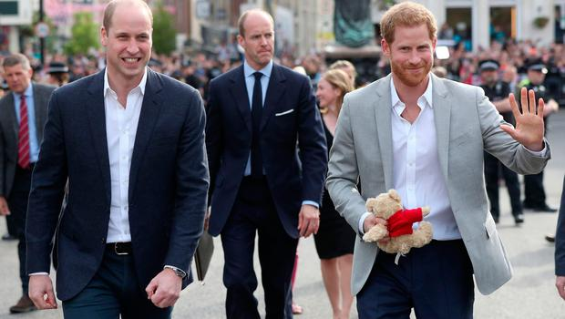 Britain's Prince Harry (R) and Prince Harry's brother and best man Prince William, Duke of Cambridge greet well-wishers on the street outside Windsor Castle in Windsor on May 18, 2018, the eve of Britain's Prince Harry's royal wedding to US actress Meghan Markle.  Britain's Prince Harry and US actress Meghan Markle will marry on May 19 at St George's Chapel in Windsor Castle. / AFP PHOTO / POOL / Jonathan BradyJONATHAN BRADY/AFP/Getty Images