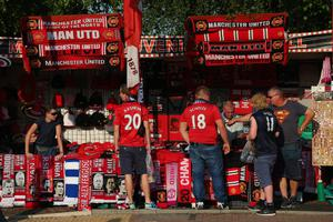 MANCHESTER, ENGLAND - AUGUST 26:  General View of merchandise stalls prior to the Barclays Premier League match between Manchester United and Chelsea at Old Trafford on August 26, 2013 in Manchester, England.  (Photo by Alex Livesey/Getty Images)