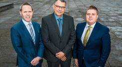 Michael Neill, head of office at Top 100 sponsor A&LGoodbody in Belfast, Moy Park chief financial officer Flavio Malnarcic and Ulster Business editor, John Mulgrew
